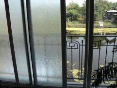 Тонування сонцезахисною плівкою склопакетів будинків, офісів, п