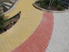 Укладання тротуарної плитки, утеплене фасадів полистеролбетонными